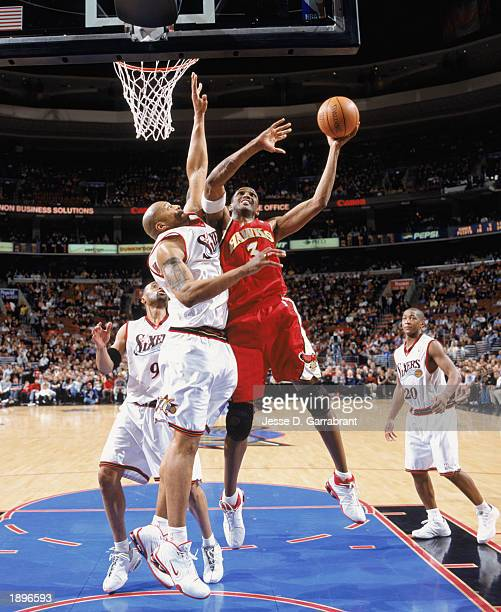 Shareef Abdur-Rahim of the Atlanta Hawks takes the ball up against Derrick Coleman of the Philadelphia 76ers during the game at First Union Center on...