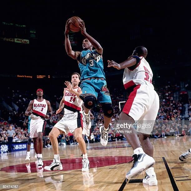 Shareef AbdurRahim of the Vancouver Grizzlies drives to the basket against the Portland Trail Blazers on October 25 1996 at the The Rose Garden in...