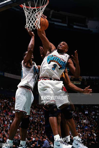 Shareef AbdurRahim of the Vancouver Grizzlies grabs a rebound against the Golden State Warriors circa 1998 at General Motors Place in Vancouver...