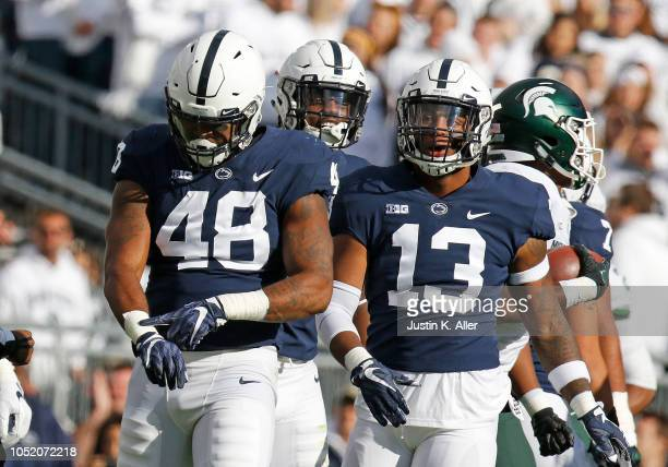 Shareef Miller of the Penn State Nittany Lions reacts after wrapping up La'Darius Jefferson of the Michigan State Spartans on October 13 2018 at...