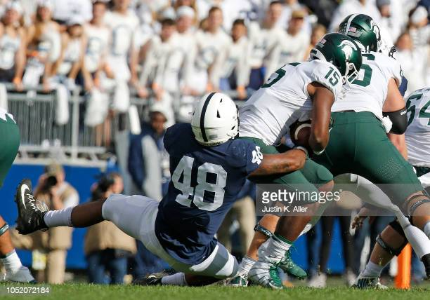 Shareef Miller of the Penn State Nittany Lions tackles La'Darius Jefferson of the Michigan State Spartans on October 13 2018 at Beaver Stadium in...