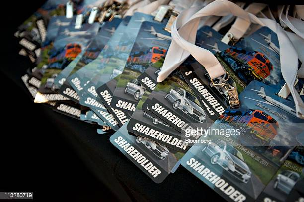 Shareholder credentials for the 2011 Berkshire Hathaway Inc shareholders meeting sit on a table at the Qwest Center venue for tomorrow's meeting in...