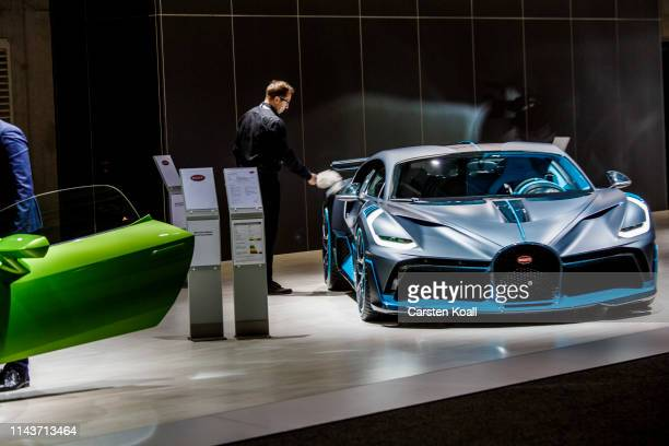 Shareholder looks at a Bugatti during the Volkswagen AG company's annual shareholders' meeting on May 14, 2019 in Berlin, Germany. Volkswagen is...