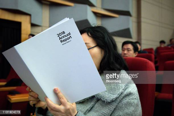 A shareholder reads an annual report during the Hyundai Motor Co annual shareholders meeting at the company's headquarters in Seoul South Korea on...