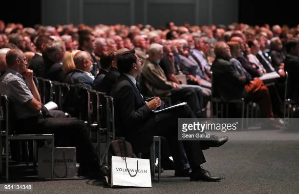 Shareholders attend German car manufacturer Volkswagen AG's annual general shareholders' meeting on May 3 2018 in Berlin Germany Herbert Diess the...