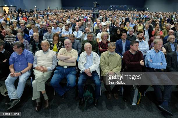 Shareholders attend the annual Daimler AG shareholders meeting on May 22 2019 in Berlin Germany Daimler has struggled with falling sales in its...