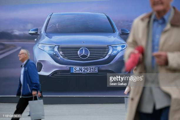 Shareholders depart from the annual Daimler AG shareholders meeting on May 22, 2019 in Berlin, Germany. Daimler has struggled with falling sales in...