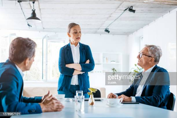 shareholders during business meeting - shareholder stock pictures, royalty-free photos & images