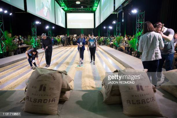 Shareholders experience a hands on coffeeraking exhibit at the Annual Meeting of Shareholders in Seattle Washington on March 20 2019