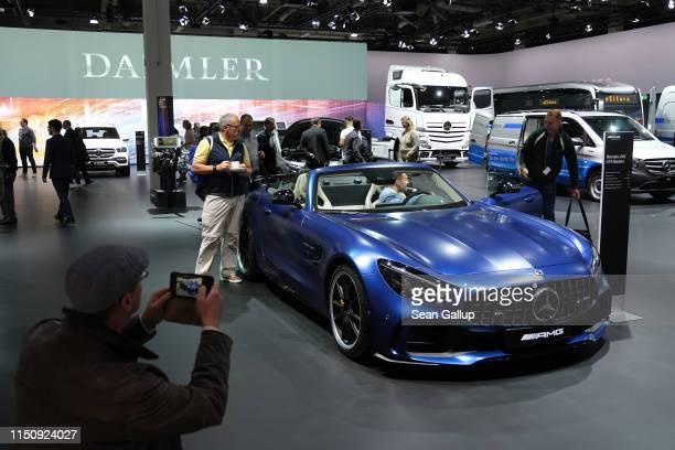 Shareholders inspect a Mercedes-Benz AMG GT-R roadster car prior to the annual Daimler AG shareholders meeting on May 22, 2019 in Berlin, Germany....