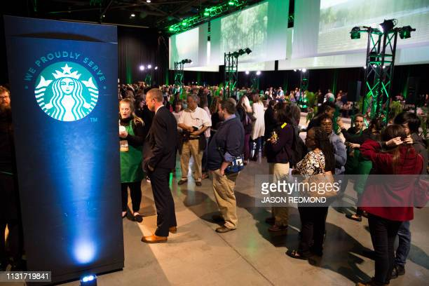 Shareholders line up for coffee at the Annual Meeting of Shareholderss in Seattle Washington on March 20 2019