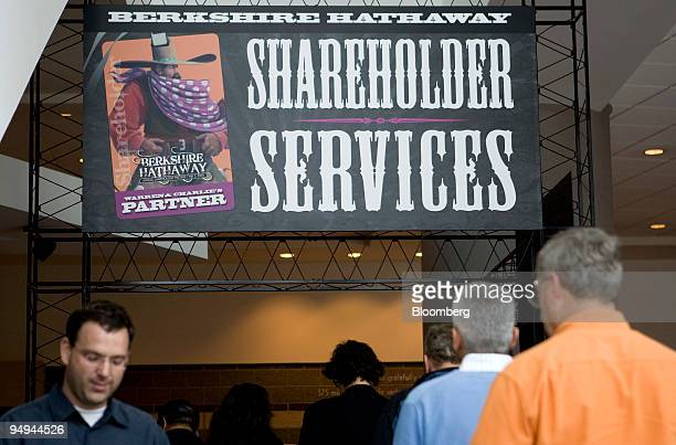 Shareholders line up to get Berkshire Hathaway Inc meeting credentials at the Qwest Center in Omaha Nebraska US on Friday May 1 2009 Berkshire is...