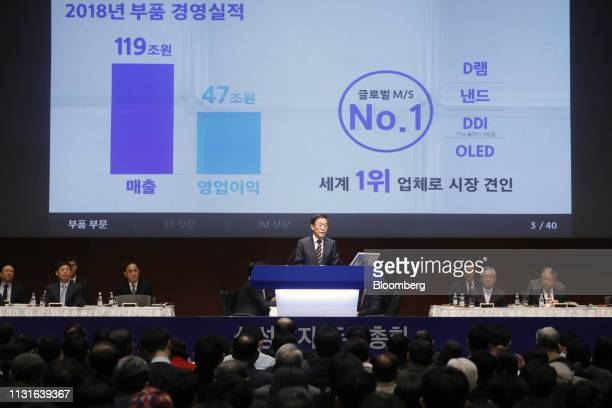 Shareholders listen to Kim Kinam president and cochief executive officer of Samsung Electronics Co speaking during the company's annual general...