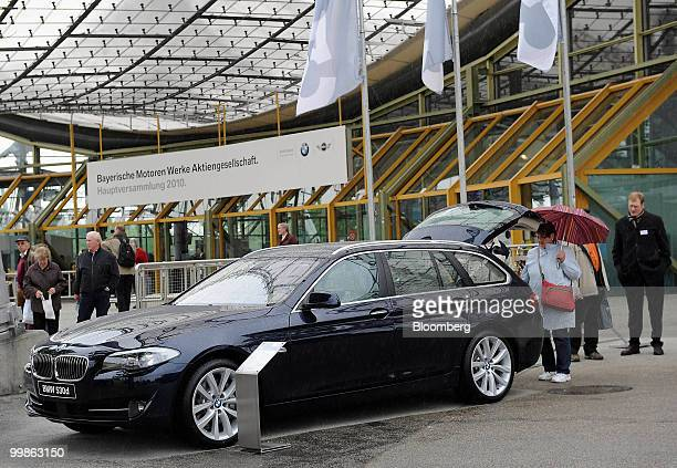 Shareholders look at a BMW 5 series car at the Bayerische Motorenwerke shareholders' meeting in Munich Germany on Tuesday May 18 2010 Bayerische...