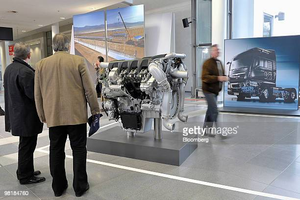 Shareholders look at MAN truck engine during the company's annual shareholders' meeting in Munich, Germany, on Thursday, April 1, 2010. MAN SE,...