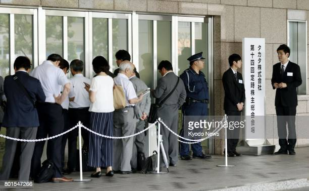 Shareholders of air bag maker Takata Corp gather for their general meeting in Tokyo on June 27 a day after the company announced that it has filed...
