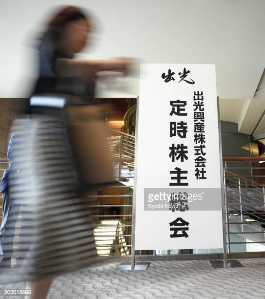 Shareholders of Idemitsu Kosan Co head for their general meeting in Tokyo on June 29 2017 The management integration of the major oil distributor and...