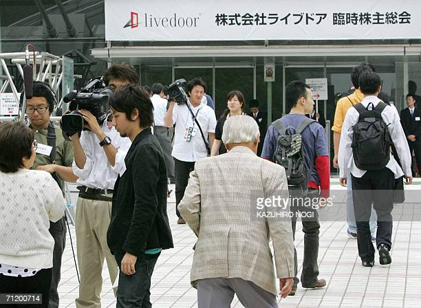 Shareholders of Japan's internet firm Livedoor Co proceed to an extraordinary general shareholders meeting at Makuhari Messe convention center in...