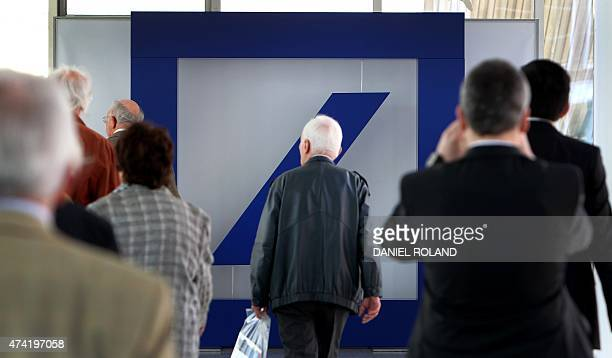 Shareholders of the Deutsche Bank arrive for the company's annual shareholder meeting in Frankfurt/Main Germany on May 21 2015 Deutsche Bank has...