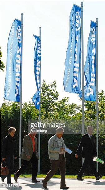 Shareholders pass flags with the Allianz logo on their way to the company's shareholders meeting in Munich Germany Wednesday May 2 2007 Allianz SE...