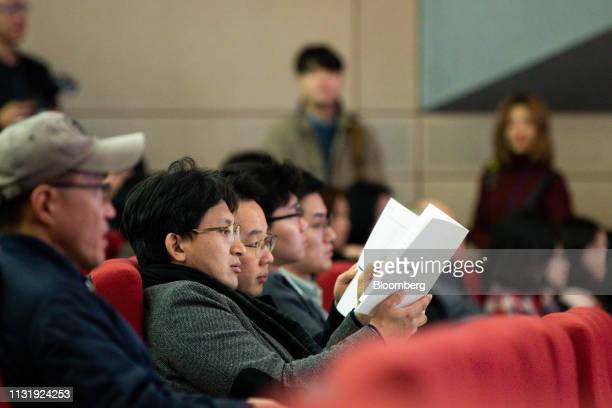 Shareholders read annual reports during the Hyundai Motor Co annual shareholders meeting at the company's headquarters in Seoul South Korea on Friday...