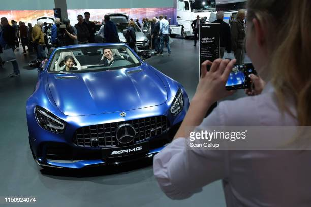 Shareholders sit in a Mercedes-Benz AMG GT-R roadster car prior to the annual Daimler AG shareholders meeting on May 22, 2019 in Berlin, Germany....