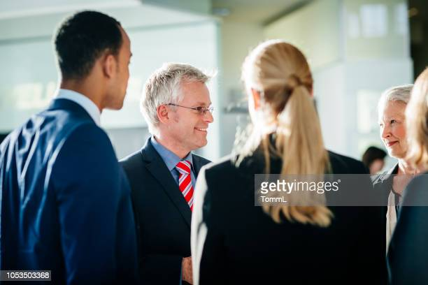 shareholders talking to business team leaders - shareholder stock pictures, royalty-free photos & images
