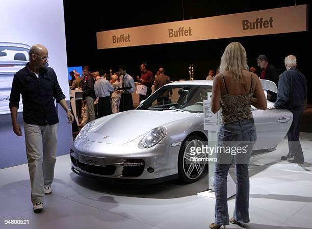 Shareholders view a Porsche 911 Turbo prior to a Porsche AG extraordinary shareholders meeting in Stuttgart Germany on Tuesday June 26 2007 Porsche...