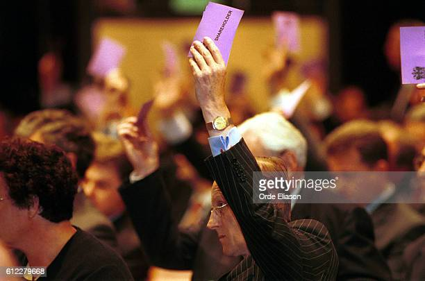 Shareholders vote during the London Stock Exchange AGM at the InterContinental Hotel