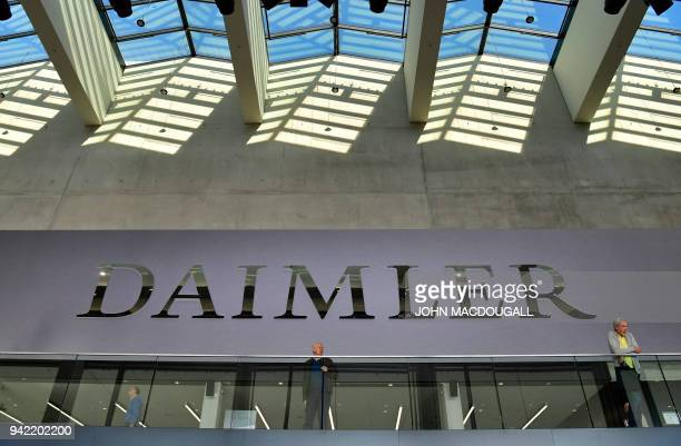 Shareholders wait for the start of German luxury car manufacturer Daimler's annual general meeting in Berlin on April 5 2018 / AFP PHOTO / John...