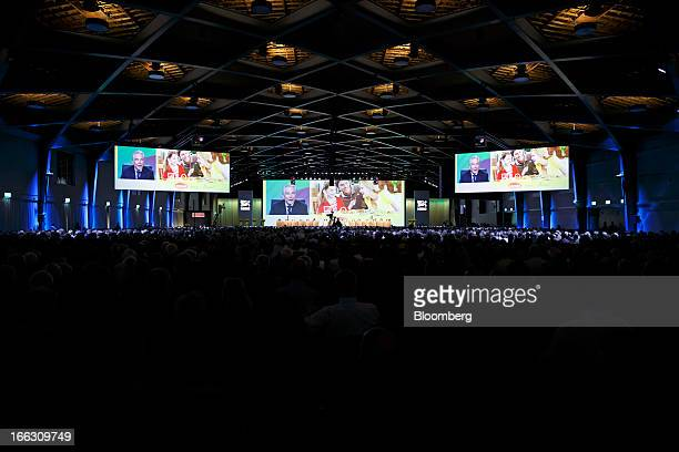 Shareholders watch giant screens as Peter BrabeckLetmathe chairman of Nestle SA speaks during the company's annual general meeting in Lausanne...