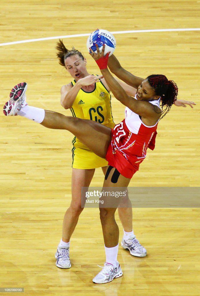 Sharelle McMahon of Australia and Sonia Mkoloma of England compete for the ball during the Women Semifinals Match between Australia and England at the Thyagaraj Sports Complex during day nine of the 2010 Commonwealth Games on October 12, 2010 in Delhi, India.