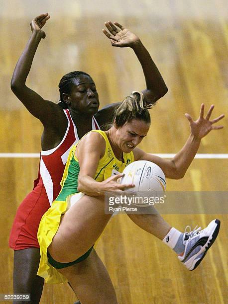 Sharelle McMahon of Australia in action against Sonia Mkoloma of England during the International Netball Test between Australia and England at the...
