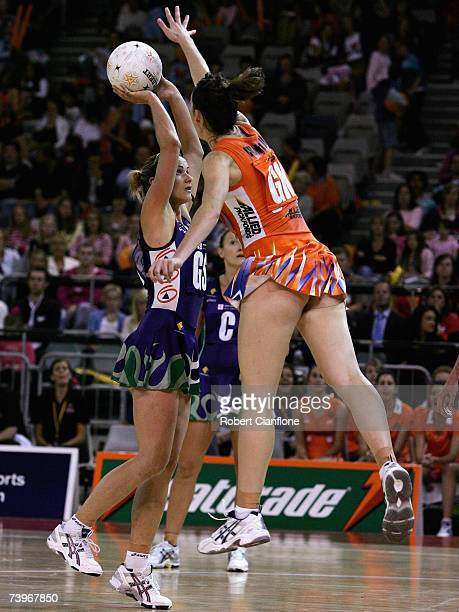 Sharelle McMahon of the Phoenix is challenged by Melinda Cranston of the Krestrels during the round one 2007 Commonwealth Bank Trophy match between...