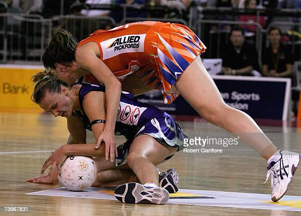 Sharelle McMahon of the Phoenix stubbles over Melinda Cranston of the Krestrels during the round one 2007 Commonwealth Bank Trophy match between the...