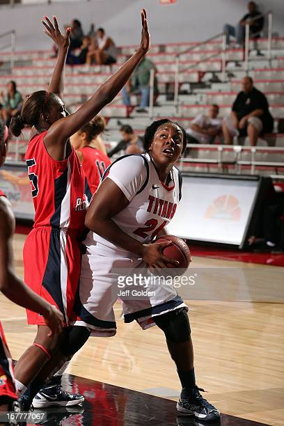 Shareta Brown of the Detroit Titans drives against Veronica Cherizol of the South Alabama Jaguars at The Matadome on November 24 2012 in Northridge...
