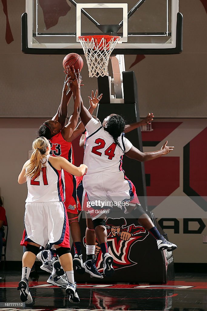 Shareta Brown #24 of the Detroit Titans jumps and wins a defensive rebound against Mary Nixon #23 of the South Alabama Jaguars at The Matadome on November 24, 2012 in Northridge, California. South Alabama defeated Detroit 59-56.