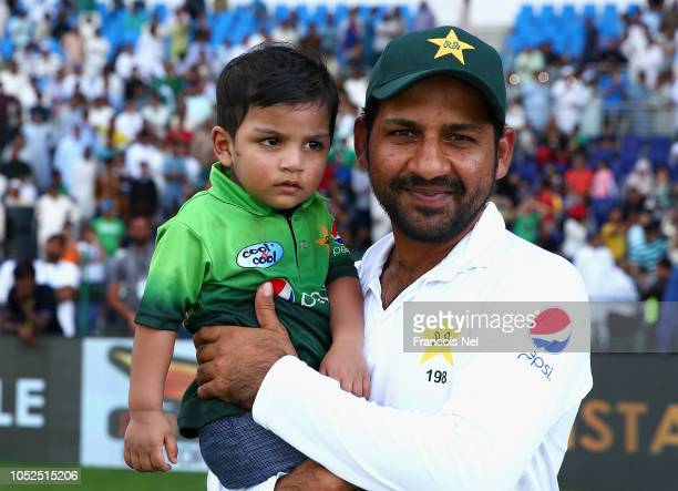 Sharfraz Ahmed of Pakistan and his Mohammed Abdulla pose for a picture after the Second Test match between Australia and Pakistan at Sheikh Zayed...