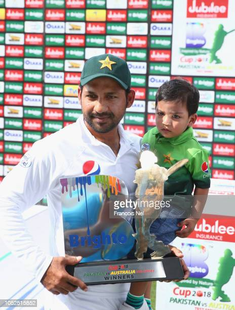 Sharfraz Ahmed of Pakistan and his son Mohammed Abdulla pose for a picture after the Second Test match between Australia and Pakistan at Sheikh Zayed...