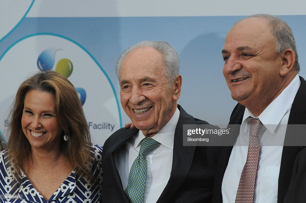 Shari Arison, owner of the Arison Group, Shimon Peres, Israel's president, and Yitzhak Tshuva, head of Delek Group, pose at the opening event of a new desalination facility in Hadera, Israel, on Sunday, May 16, 2010. Israeli companies have 'endless' possibilities to sell clean technology to China in areas such as water recycling, desalination and solar power, Environmental Protection Minister Gilad Erdan said. Photographer: Ahikam Seri/Bloomberg via Getty Images