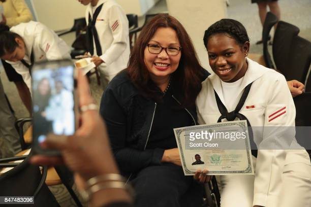 Shari Mahon from Jamaica and currently serving in the US Navy at Naval Station Great Lakes poses for a picture with US Senator Tammy Duckworth after...