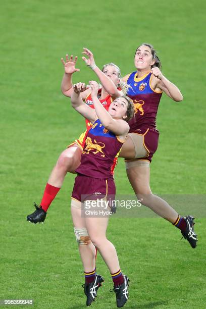 Shari Webb of the Lions and Holly Mirfield of the Suns compete for the ball during the AFLW Winter Series match between the Gold Coast Suns and the...