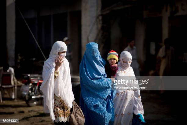 Sharia law has been reinstated by Taliban militants which makes it compulsory for women to wear the burqa March 31 2009 in Mardan NorthWest Frontier...