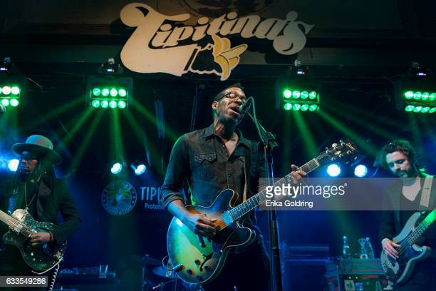Sharief Hobley Claude Coleman Jr and Jon Sullivan of Amandla perform at Tipitina's on February 1 2017 in New Orleans Louisiana