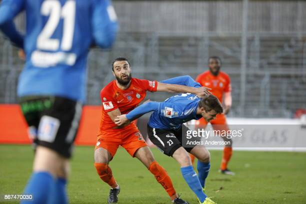 Sharif Mukhammad of Athletic FC Eskilstuna and Jonathan Svedberg of Halmstad BK compete for the ball during the Allsvenskan match between Halmstad BK...