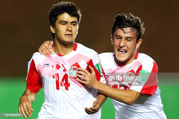 Sharifbek Rahmatov of Tajikistan left celebrates with Amadoni Kamolov after scoring a goal during the FIFA U17 World Cup Brazil 2019 group E match...