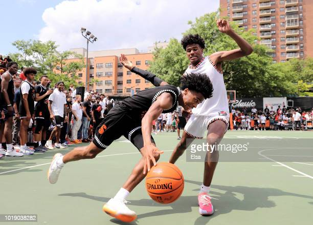 Sharife Cooper of Team Ramsey heads for the net as Jalen Green of Team Stanley defends during the SLAM Summer Classic 2018 at Dyckman Park on August...