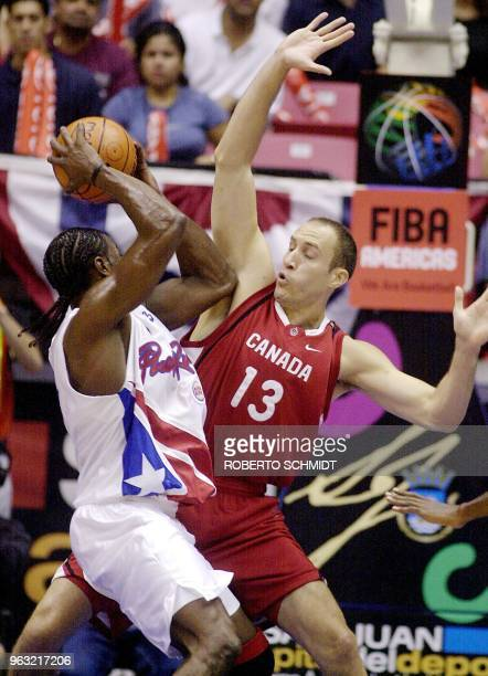 Shariff Fajardo of Puerto Rico tries to keep the ball away from Peter Guarasci of Canada at the Roberto Clemente Coliseum in San Juan Puerto Rico 21...