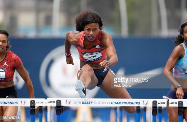 Sharika Nelvis clears a hurdle on her way to victory in the Womens 100 Meter Hurdles Semifinal during day 3 of the 2018 USATF Outdoor Championships...