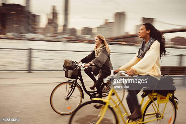 sharing a bicycle ride my friend in nyc - city life stock pictures, royalty-free photos & images